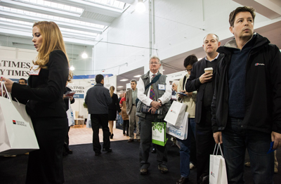 Attendees wait with goodie bags at the London Investor Show